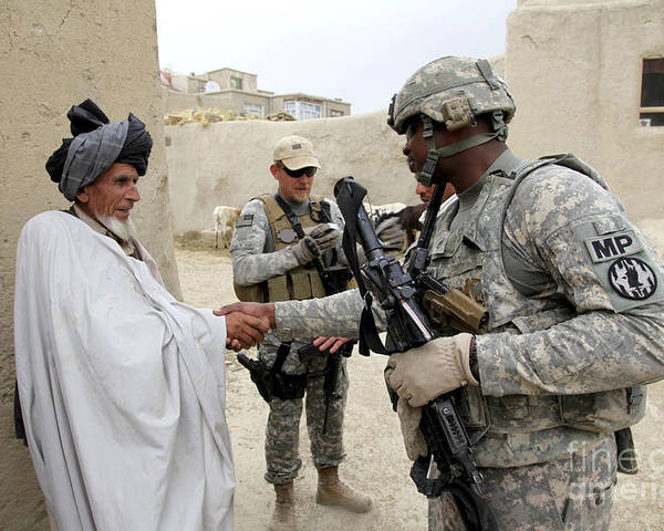 Middle East Poster featuring the photograph U.s. Army Soldier Shakes Hands With An by Stocktrek Images