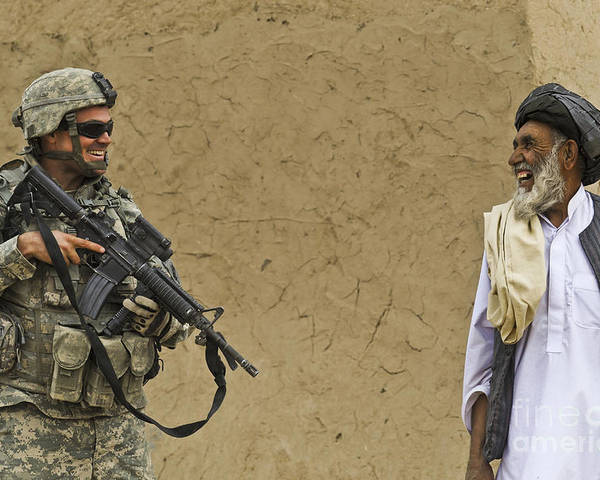 Afghan National Army Poster featuring the photograph U.s. Army Specialist Talks To An Afghan by Stocktrek Images
