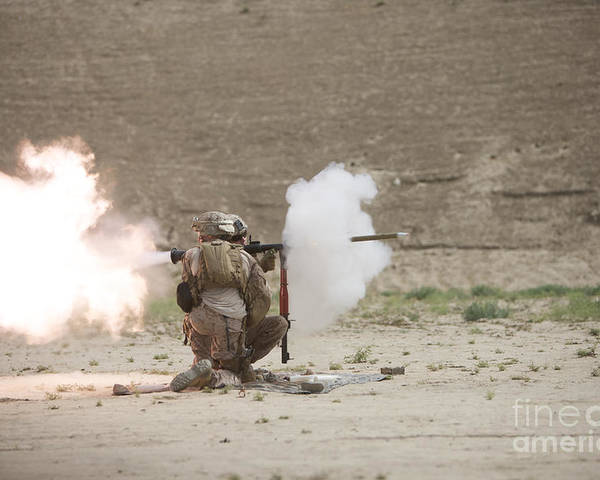 Desert Poster featuring the photograph U.s. Marines Fire A Rpg-7 Grenade by Terry Moore