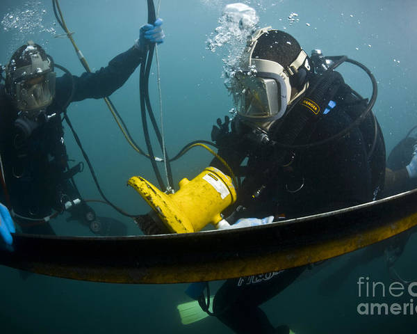 Hydraulic Grinder Poster featuring the photograph U.s. Navy Diver Instructs A Barbados by Stocktrek Images