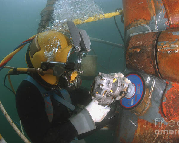 Adults Only Poster featuring the photograph U.s. Navy Diver Uses A Grinder To File by Stocktrek Images