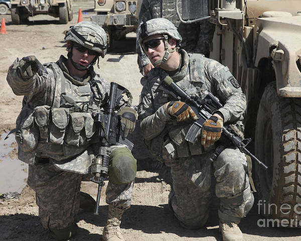 Military Poster featuring the photograph U.s. Soldiers Coordinate Security by Stocktrek Images