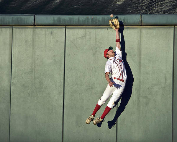 25-29 Years Poster featuring the photograph Usa, California, San Bernardino, Baseball Player Making Leaping Catch At Wall by Donald Miralle