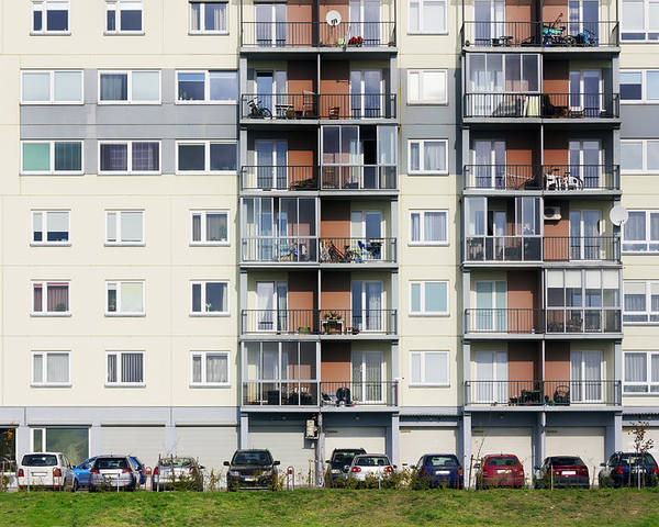 Building Poster featuring the photograph Windows Balconies Cars And Lawn Of A Multiroom Apartment Hous by Aleksandr Volkov