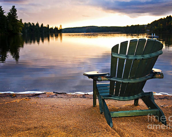 Lake Poster featuring the photograph Wooden Chair At Sunset On Beach by Elena Elisseeva