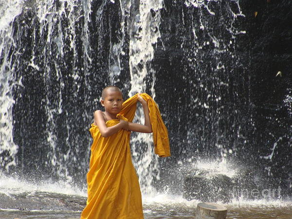 Buddhism Poster featuring the photograph Young Monk In Front Of Waterfall by Jarrod Brown