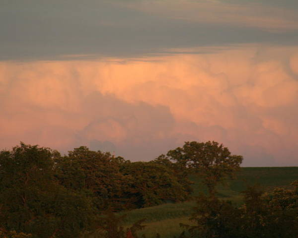 A Very Peaceful Scene Poster featuring the photograph Clouds Of A Distant Storm by Linda Ostby