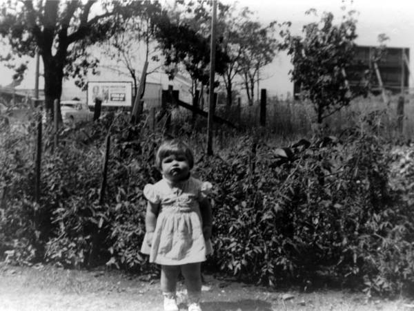 Girl Poster featuring the photograph Girl Tomato Patch 1950s Black White Archive Kids by Mark Goebel