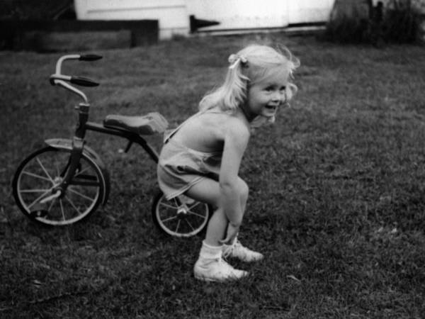 Girl poster featuring the photograph girl tricycle circa 1940 black white 1940s kids by mark goebel