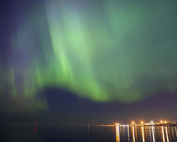 Astronomy Poster featuring the photograph Aurora Borealis Northern Lights Over City Of Tallinn North Europe by Sandra Rugina
