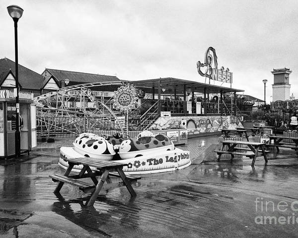 Empty Poster featuring the photograph Empty Outdoor Amusement Park On A Cold Wet British Summer Day North Wales Uk by Joe Fox