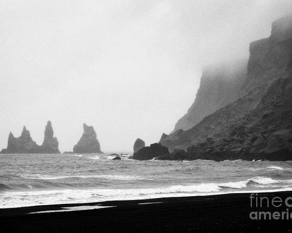Black Poster featuring the photograph mist rolling in on black sand vik beach and Vik i Myrdal Iceland by Joe Fox