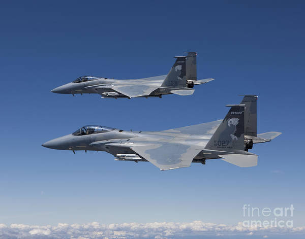 Color Image Poster featuring the photograph Two F-15 Eagles Conduct Air-to-air by HIGH-G Productions