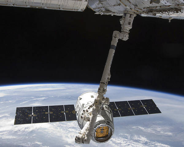 Color Image Poster featuring the photograph The Spacex Dragon Cargo Craft by Stocktrek Images