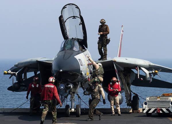 Grumman Poster featuring the photograph An F-14d Tomcat On The Flight Deck by Gert Kromhout