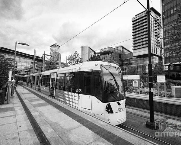 Metrolink Poster featuring the photograph metrolink trams at mediacity station Manchester uk by Joe Fox