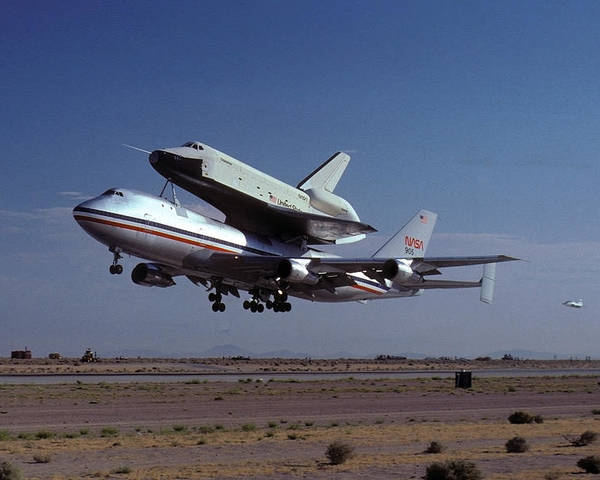 Space Poster featuring the photograph 747 Takes Off With Space Shuttle Enterprise For Alt-1 by Brian Lockett
