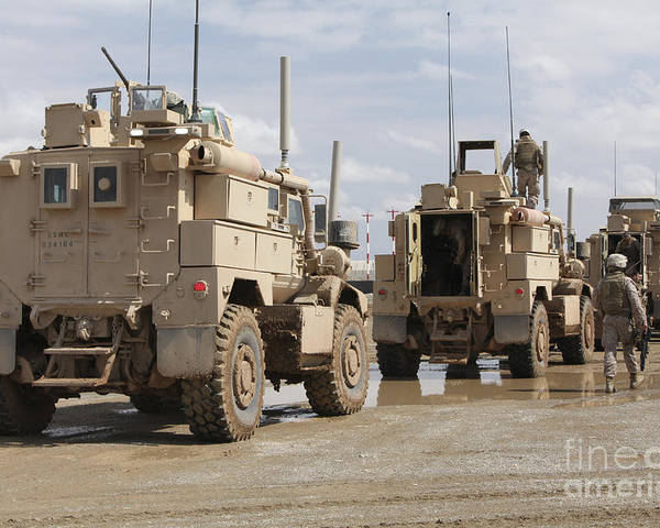 In A Row Poster featuring the photograph A Convoy Of Mrap Vehicles Near Camp by Stocktrek Images