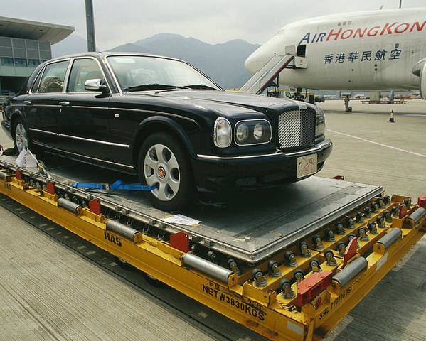 Asia Poster featuring the photograph A Luxury Bentley Unloaded From An by Justin Guariglia