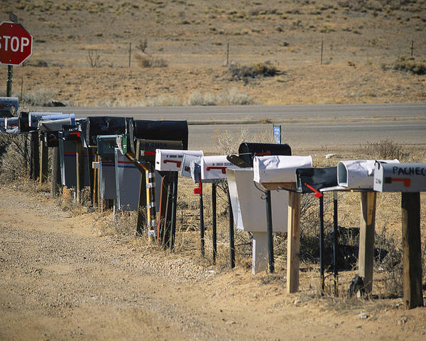 Outdoors Poster featuring the photograph A Parade Of Mailboxes On The Outskirts by Stephen St. John
