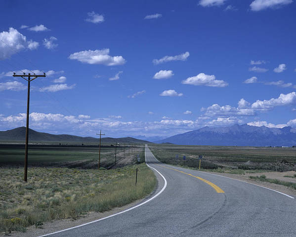 Colorado Poster featuring the photograph A Road Disappears Into The Distance by Taylor S. Kennedy
