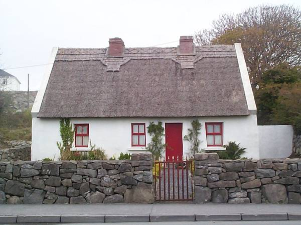 Ireland Poster featuring the photograph A Wee Small Cottage by Charles Kraus