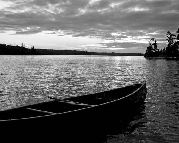 Absence Poster featuring the photograph Abandoned Canoe Floating On Water by Keith Levit