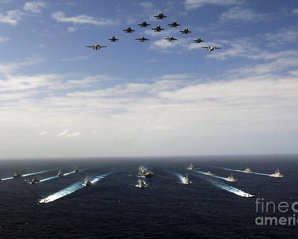 Horizontal Poster featuring the photograph Aircraft Fly Over A Group Of U.s by Stocktrek Images
