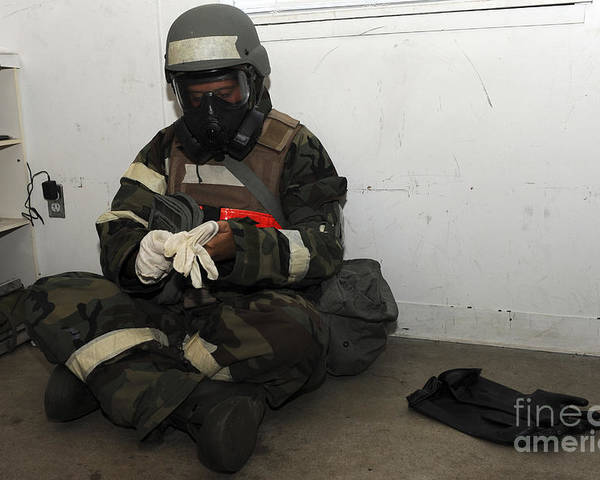 Military Poster featuring the photograph Airman Dons His Chemical Warfare by Stocktrek Images
