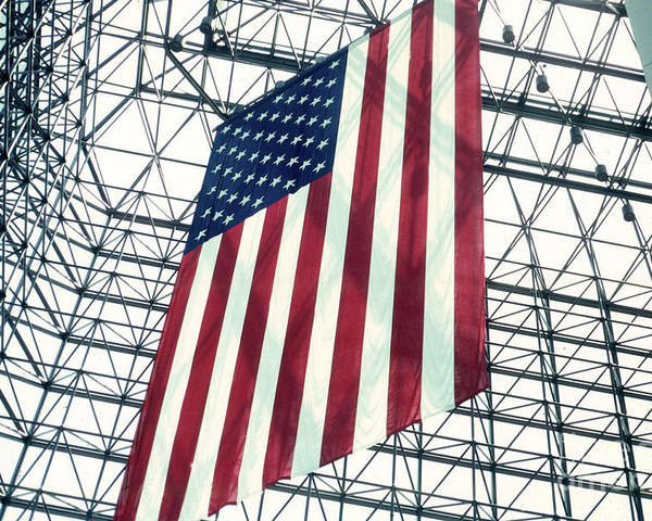 Flag Poster featuring the photograph American Flag In Kennedy Library Atrium - 1982 by Thomas Marchessault
