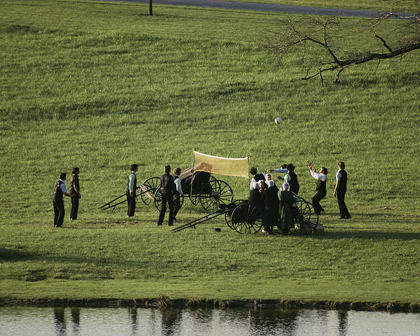 Ideologies Poster featuring the photograph Amish Buggies Anchor A Volleyball Net by Ira Block