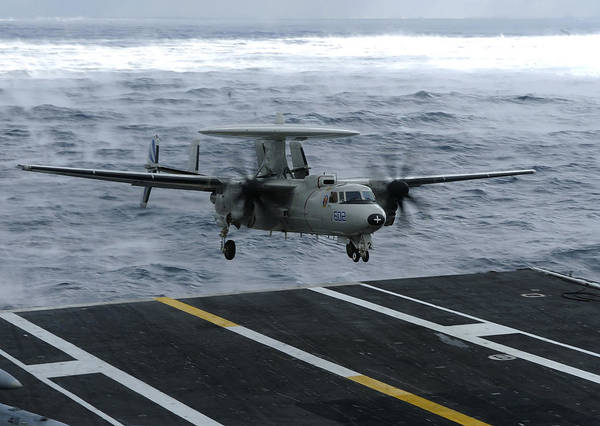 Aircraft Carrier Poster featuring the photograph An E-2c Hawkeye Lands Aboard by Stocktrek Images