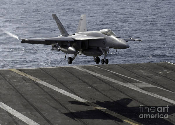 Aircraft Poster featuring the photograph An Fa-18e Super Hornet Prepares To Land by Stocktrek Images