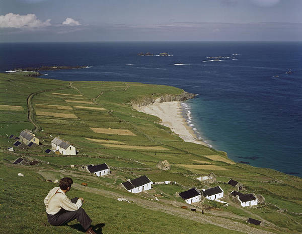 Great Blasket Island Poster featuring the photograph An Irishman Overlooks Cottages That by Howell Walker