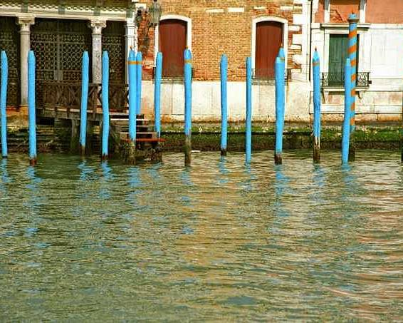 Venice Poster featuring the photograph Blue Poles In Venice by Michael Henderson