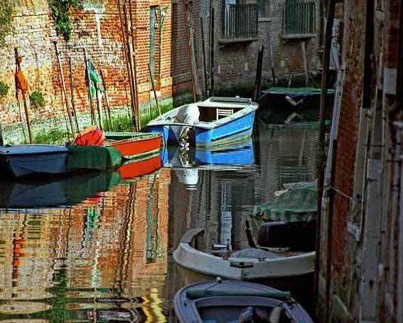 Venice Poster featuring the photograph Boats On Canal In Venice by Michael Henderson