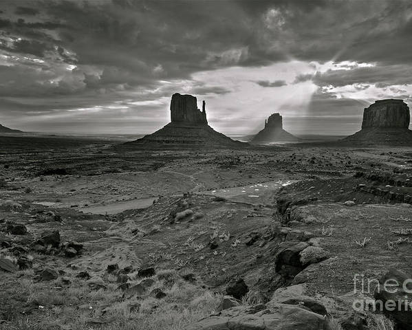 Monument Valley Poster featuring the photograph Breaking Light At Monument Valley - Black And White by Brian Stamm
