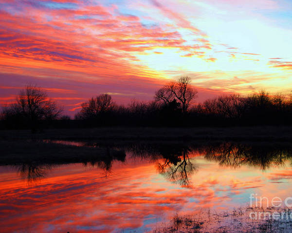 Clouds Poster featuring the photograph Calming Sunset by Larry Keahey