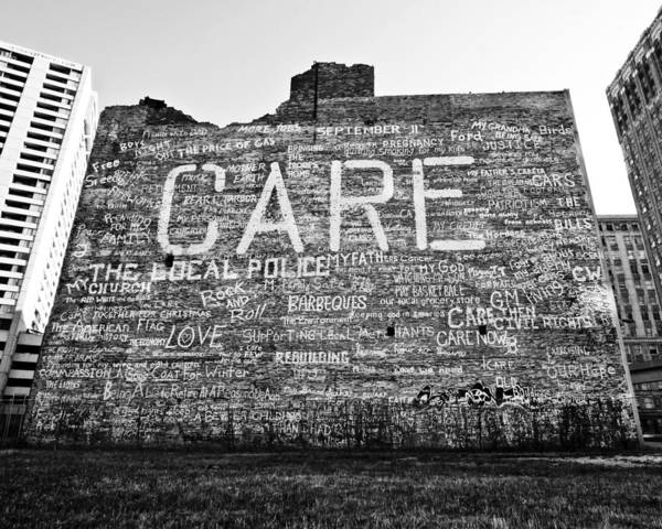 Building Poster featuring the photograph Care Graffiti Building by Alanna Pfeffer