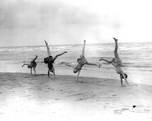 Young Adult Poster featuring the photograph Cartwheels by Fox Photos