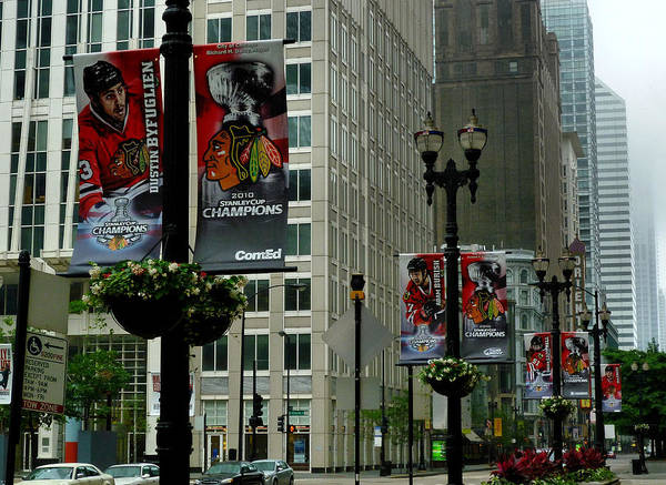 Chicago Blackhawk Flags Poster featuring the photograph Chicago Blackhawk Flags by Ely Arsha