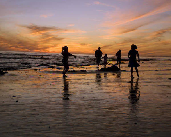 Usa Poster featuring the photograph Children Playing On The Beach At Sunset by James Forte