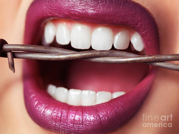 Teeth Poster featuring the photograph Closeup Of Woman's Mouth Biting On Barbed Wire by Oleksiy Maksymenko
