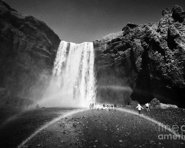 Skogafoss Poster featuring the photograph Crowds Of Tourists With Double Rainbow At Skogafoss Waterfall In Iceland by Joe Fox