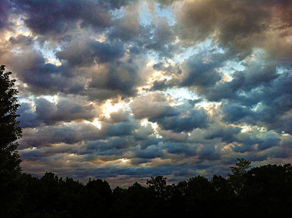 Clouds Poster featuring the photograph Deceptive Clouds by Cricket Hackmann
