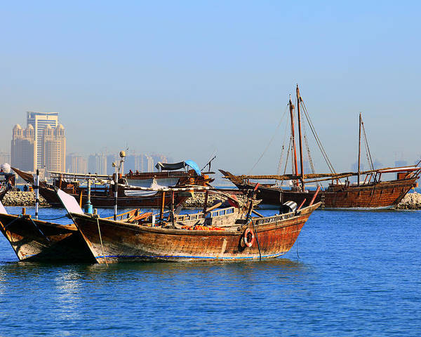 Dhow Poster featuring the photograph Dhows In Doha Bay by Paul Cowan