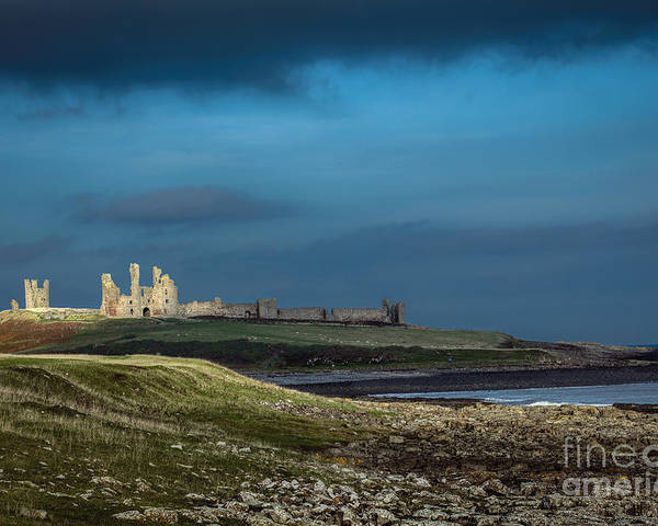 Dunstanburgh Poster featuring the photograph Dunstanburgh Castle In Northumberland by Philip Pound