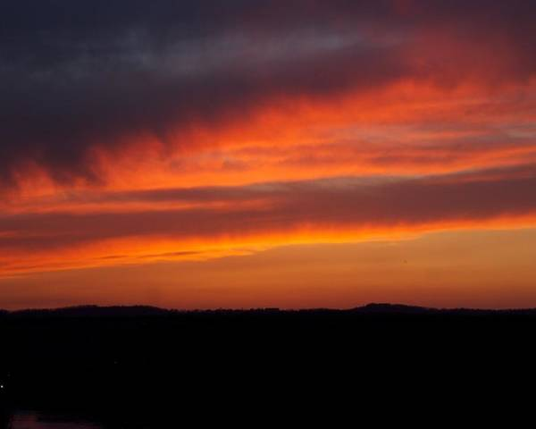 Red Sunset Poster featuring the photograph Firey Skies by Toni Berry
