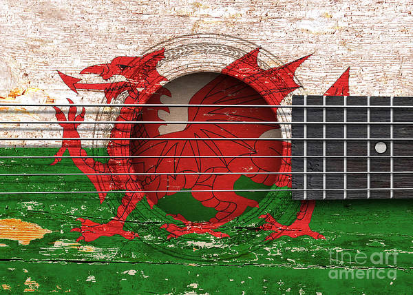 Acoustic Guitar Poster featuring the digital art Flag Of Wales On An Old Vintage Acoustic Guitar by Jeff Bartels