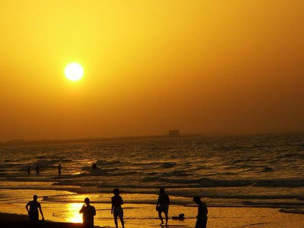 Sunset Poster featuring the photograph Football And Sunset At The Beach by Sunaina Serna Ahluwalia